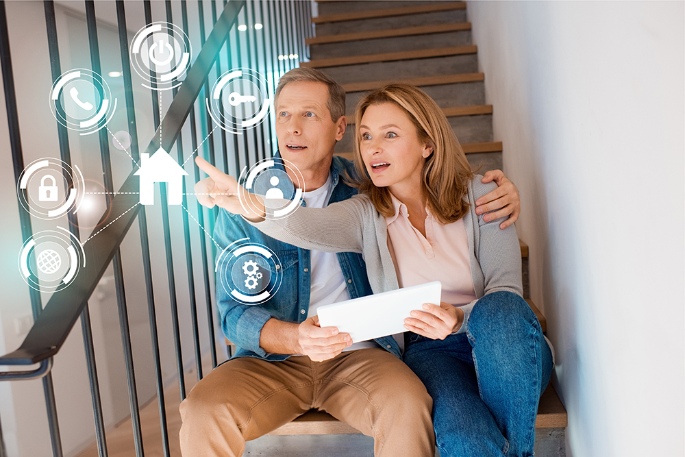 wife pointing hand while sitting with husband on stairs and usin